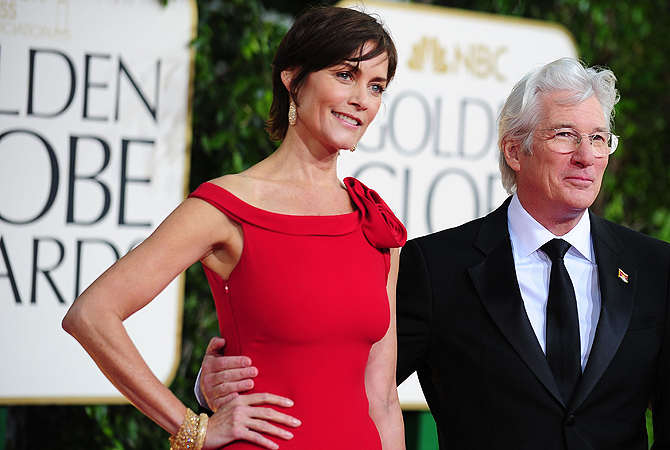 Actor Richard Gere and actress Carey Lowell arrive for the Golden Globe Awards in Beverly Hills. — AFP Photo