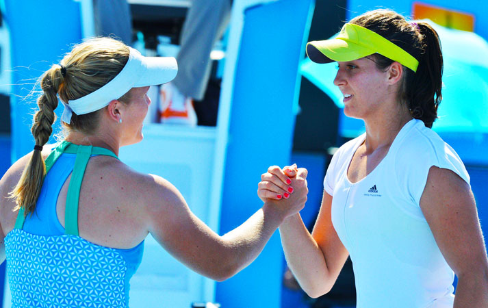 Britain's Laura Robson (R) shakes hands with Melanie Oudin of the US after her victory during their women's singles first round match.