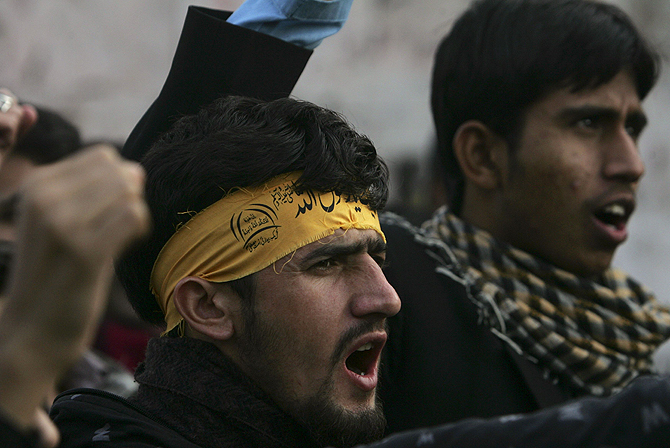 Supporters of the Imamia Students Organisation (ISO) and the Majlis-e-Wahdat-e-Muslimeen (MWM) religious group shout slogans during a protest against the bomb blasts a day earlier in Quetta, in Lahore January 11, 2013. – Photo by Reuters