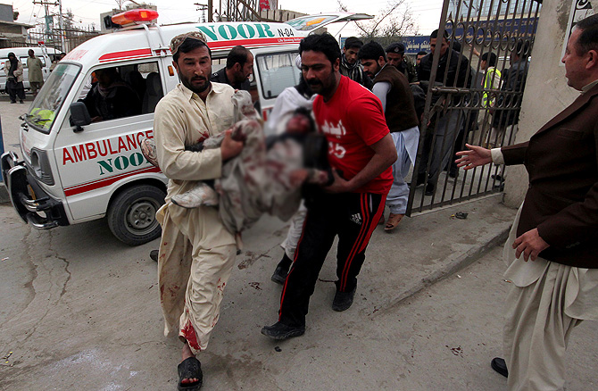 Pakistani volunteers rush an injured victim from a bomb blast in a commercial area to a local hospital in Quetta, Pakistan, Thursday, Jan. 10, 2013. – Photo by AP