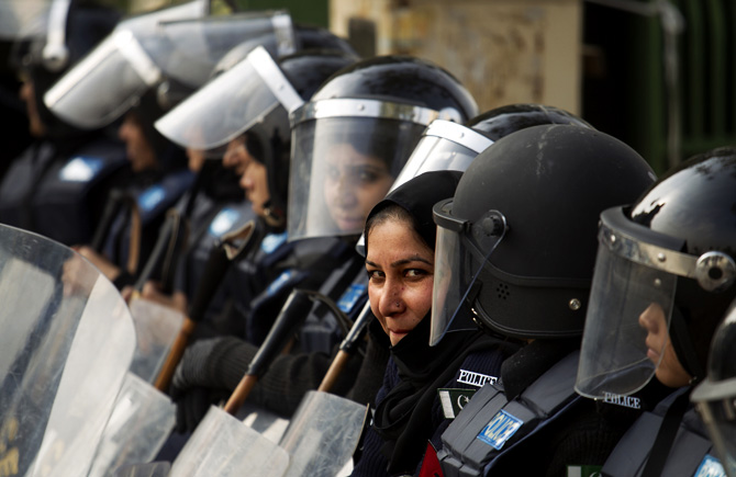 Pakistan female police officers stand guard at a venue of rally of cleric Tahir-ul-Qadri in Islamabad  on Monday, Jan. 14, 2013 in Islamabad. ? Photo by Reuters