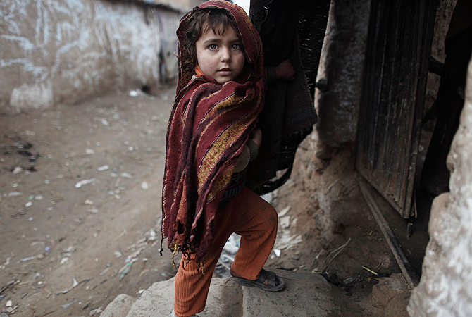 A girl stands at the entrance of her house in a slum on the outskirts of Islamabad January 8, 2013. ? Reuters Photo