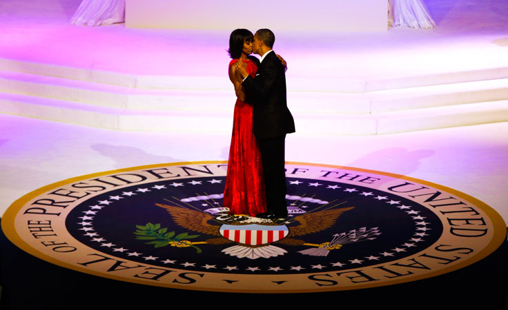 President Barack Obama and first lady Michelle Obama kiss as they dance during the inaugural ball. ?Photo by AP