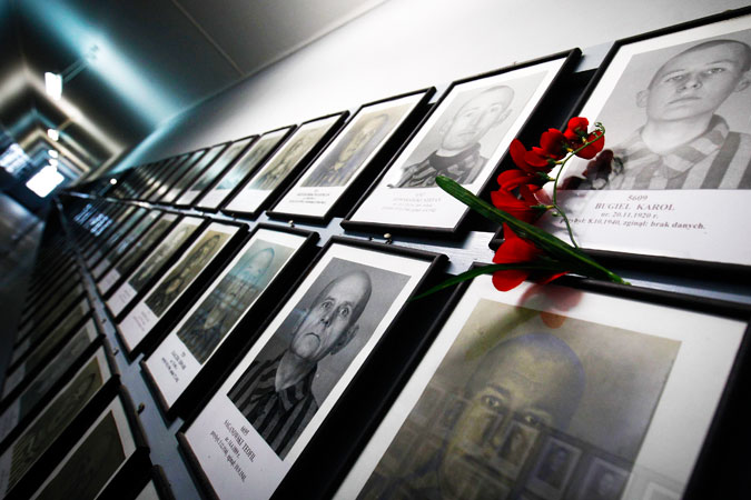 Pictures of former prisoners hang on a wall at one of the barracks at the Auschwitz concentration camp. ?Photo by Reuters