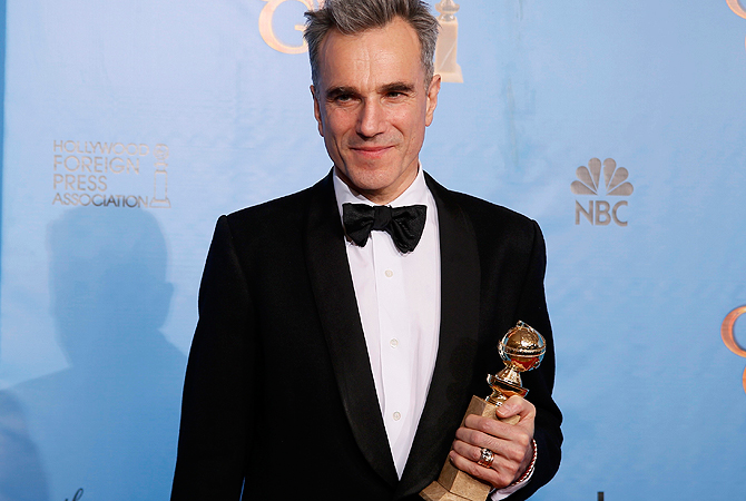 "Daniel Day-Lewis, winner for Best Actor in a Motion Picture, Drama for ""Lincoln,"" poses with his award backstage at the 70th annual Golden Globe Awards in Beverly Hills, California. — Reuters Photo"