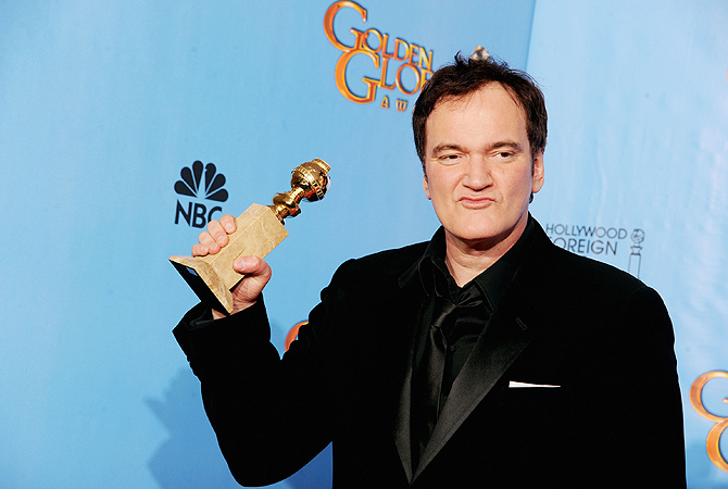 Filmmaker Quentin Tarantino, winner for Best Screenplay - Motion Picture for 'Django Unchained', poses in the press room during the 70th Annual Golden Globe Awards held at The Beverly Hilton Hotel. — AFP Photo