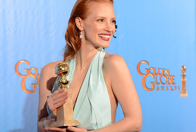 "Jessica Chastain poses in the press room with her Best Performance by an actress in a motion picture drama award for ""Zero Dark Thirty"" at the Golden Globes awards ceremony in Beverly Hills. — AFP Photo"