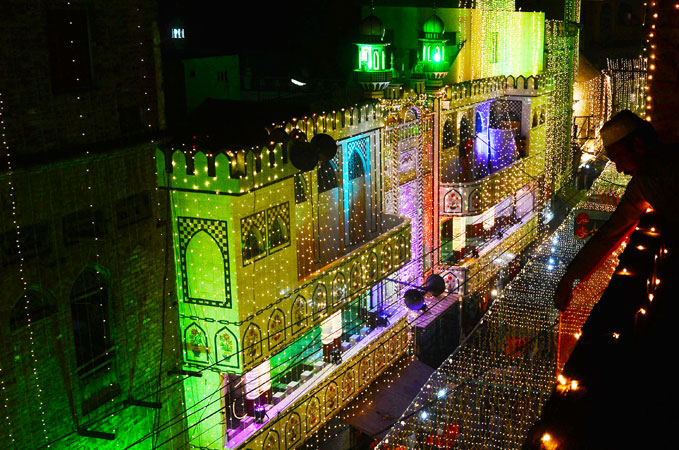 A Pakistani devotee decorates a street to mark the celebration Eid Milad-un-Nabi. ?Photo by AFP