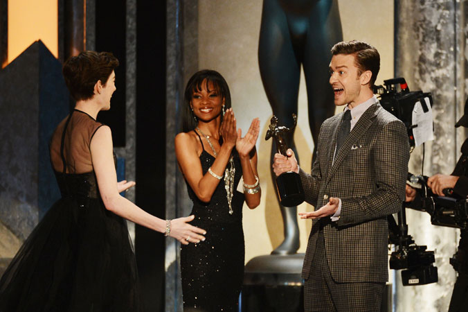 Actor/singer Justin Timberlake presents actress Anne Hathaway with the award for ?Outstanding Performance by a Female Actor in a Supporting Role? for 'Les Miserables' onstage. ?Photo by AFP