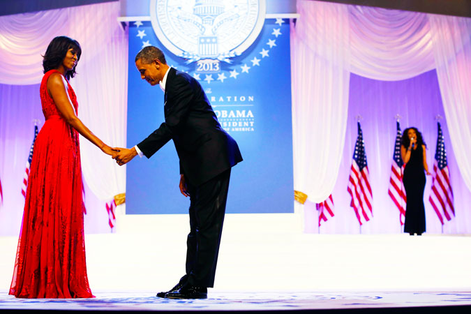 President Barack Obama bows as he asks first lady Michelle Obama for a dance. Jennifer Hudson, sings Al Green's ?Let's Stay Together? as they waltz. ?Photo by AP
