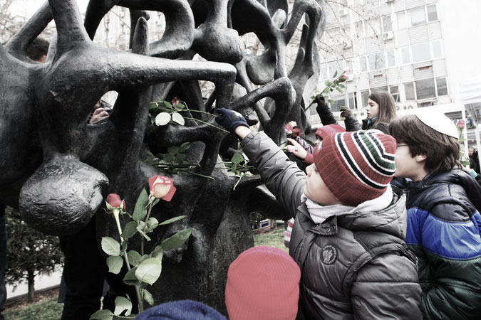 Children place flowers during a ceremony at the Holocaust Memorial commemorating the persecution of the Jewish people during World War II, in Thessaloniki. ?Photo by AFP