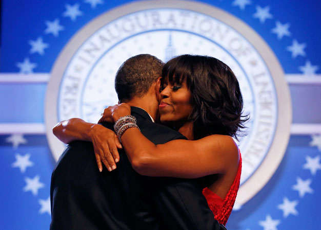 First lady Michelle Obama smiles blissfully while dancing with her husband. ?Photo by Reuters