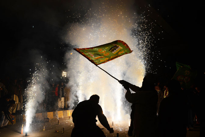 Pakistanis light fireworks as they celebrate on the eve of Eid Milad-un-Nabi. ?Photo by AFP