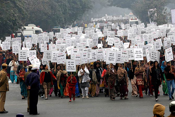 Women hold placards as they march during a rally organized by Delhi Chief Minister Sheila Dikshit (unseen) protesting for justice and security for women, in New Delhi January 2, 2013. ? AFP Photo