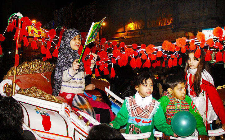Children sitting on a decorative animal cart as they participate in a torch rally at Mall Road. ?Photo by ONLINE