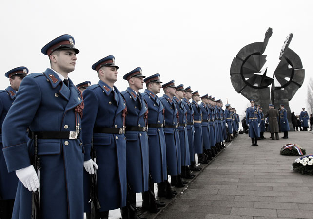Serbian military honor guards stand to attention during commemorations for victims of the Holocaust at a monument erected in the former World War II Nazi concentration camp of Sajmi?te in Belgrade, Serbia. ?Photo by AP