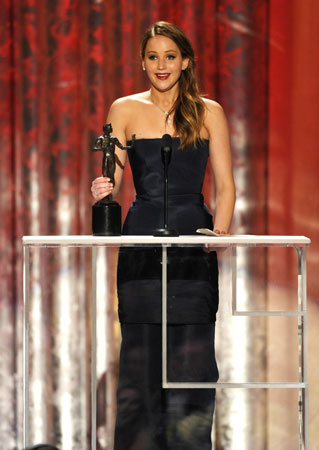 Jennifer Lawrence accepts the award for ?Outstanding Female Actor in a Leading Role? for ?Silver Linings Playbook?. ?Photo by AP
