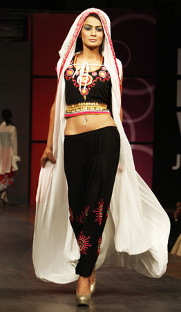 A Pakistani model presents a creation of designer duo, Faisal and Shabana. ?Photo by AP