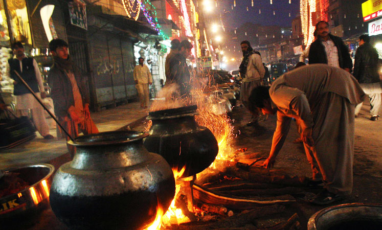 Food being prepared at Qissa Khuwani Bazaar in Peshawar on the eve of Eid Milad-un-Nabi celebrations. ?Photo by INP