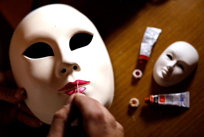 Marco Dilauro paints a mask which he will wear during the annual Venice Carnival. ? Reuters Photo