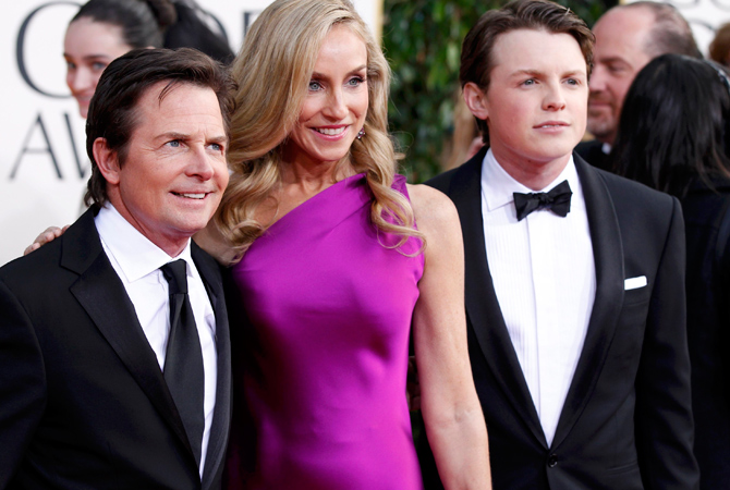 Actor Michael J. Fox, his wife Tracy Pollan and their son Sam Fox (R) arrive at the 70th annual Golden Globe Awards. — Reuters Photo