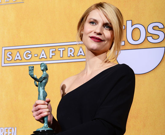 Claire Danes poses with the Screen Actors Guild Award for ?Best Performance by a Female Actor in a Drama Series? for ?Homeland? in the press room at the Shrine Auditorium. ?Photo by AFP