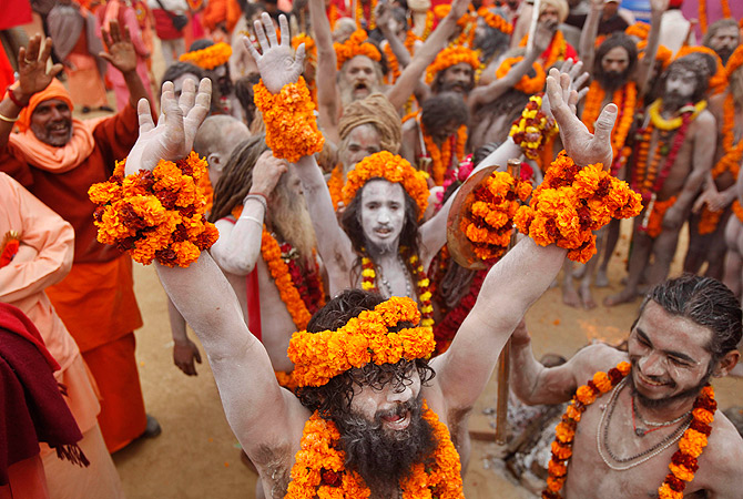 Naga Sadhus, or Naked Hindu holy men, arrive during a religious procession towards the Sangam, the confluence of rivers Ganges, Yamuna and mythical Saraswati, as part of the Mahakumbh festival in Allahabad, India, Friday, Jan. 4, 2013. Millions of Hindu pilgrims are expected to take part in the large religious congregation on the banks of the Sangam during the festival in January 2013, which falls every 12th year. ? AP Photo