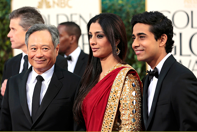 "Director Ang Lee (L) with ""Life of Pi"" cast members Tabu (C) and Suraj Sharma at the 70th annual Golden Globe Awards in Beverly Hills. — Reuters Photo"