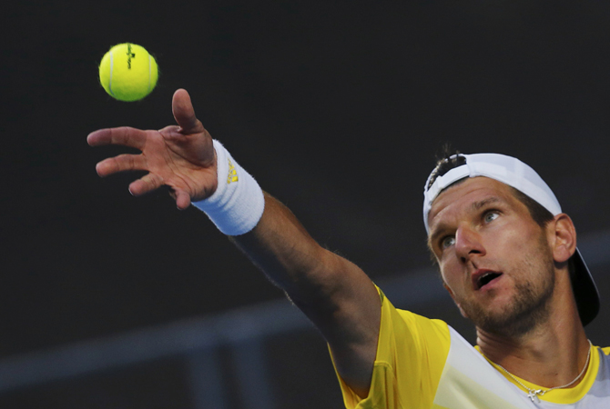 Jurgen Melzer of Austria serves to Tomas Berdych of Czech Republic during their men's singles match at the Australian Open tennis tournament in Melbourne. ? Photo by Reuters