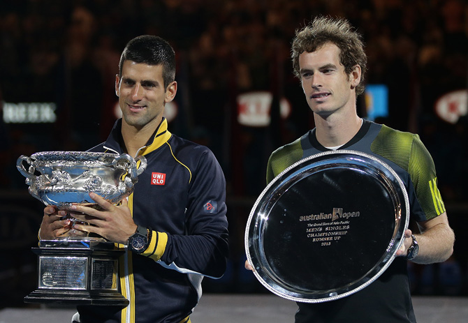 Serbia's Novak Djokovic, left,holds his trophy after defeating Britain's Andy Murray, right, in the men's final at the Australian Open tennis championship in Melbourne, Australia, Sunday, Jan. 27, 2013. – Photo by AP