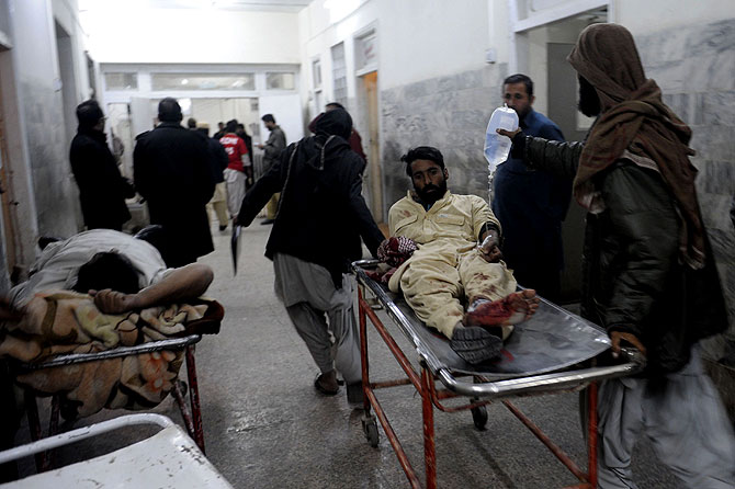 Pakistani men shift an injured train passenger at a hospital after an attack on the Jaffar Express train. – Photo by AFP