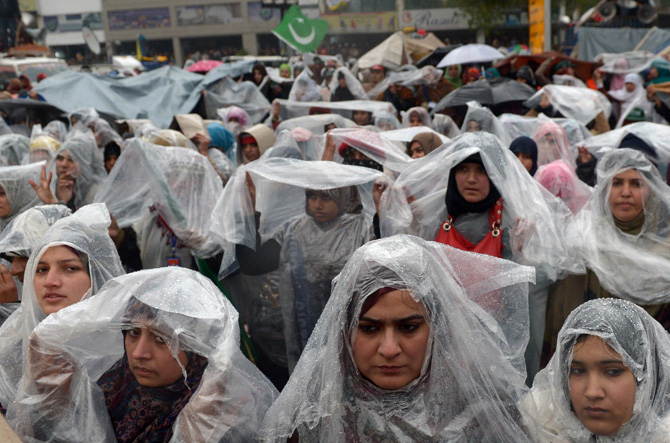 Supporters of Pakistani cleric Tahir-ul Qadri gather in the rain at a protest rally in Islamabad on January 17, 2013.  – Photo by AFP