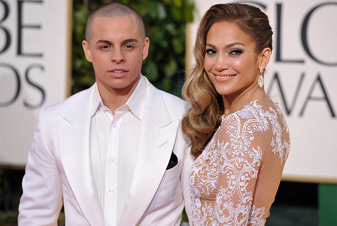 Jennifer Lopez, right, and Casper Smart arrive at the Golden Globe Awards. — AP Photo