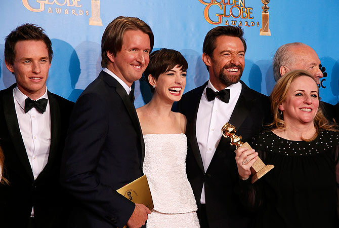"The cast and crew of ""Les Miserables"" (From L) actor Eddie Redmayne, director Tom Hooper, Anne Hathaway, Hugh Jackman and producer Debra Hayward celebrate their win for Best Motion Picture, Comedy or Musical backstage at the 70th annual Golden Globe Awards in Beverly Hills. — Reuters Photo"