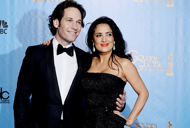 Actors Paul Rudd (L) and Salma Hayek pose in the press room during the 70th Annual Golden Globe Awards. — AFP Photo