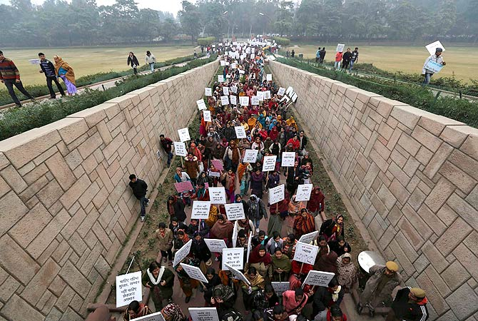 Women carrying placards enter Raj Ghat to attend a prayer ceremony for a rape victim after a rally organized by Delhi Chief Minister Sheila Dikshit (unseen) protesting for justice and security for women, in New Delhi January 2, 2013. ? Reuters Photo