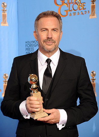 Actor Kevin Costner poses with Best Actor in a Miniseries Award in the press room during the 70th Annual Golden Globe Awards. — AFP Photo