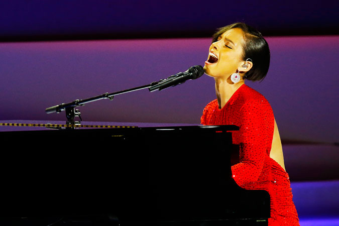 "Alicia Keys opened the evening by reworking her ?Girl on Fire? into ""Obama's on Fire"". ?Photo by AFP"