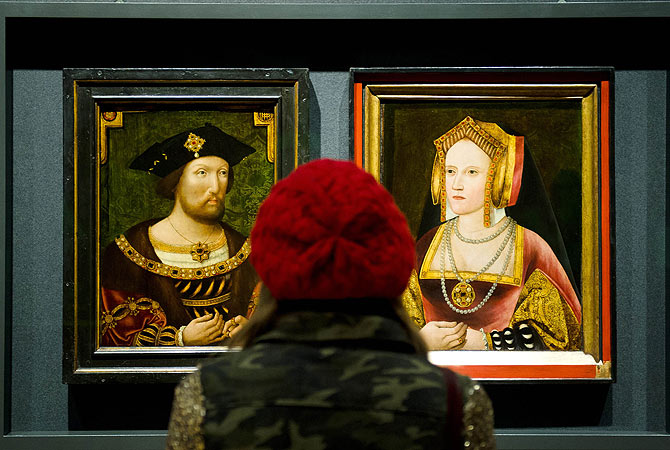 A woman looks at portraits of Britain's King Henry VIII and Catherine of Aragon, displayed together for the first time in nearly 500 years, at the National Portrait Gallery, central London. Discovered in Lambeth Palace, the portrait of Catherine of Aragon had been painted over with a picture of the King's last wife Catherine Parr but experts suspected that there may be more to the picture due to similarities with other known paintings of Catherine of Aragon.  ? AFP Photo