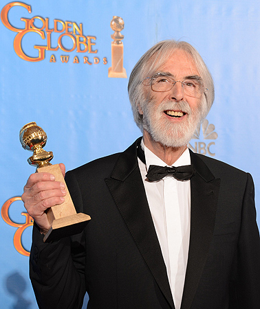 "Director Michael Haneke poses in the press room with his Best Foreign Language film award for ""Amour"" at the Golden Globes awards ceremony. — AFP Photo"