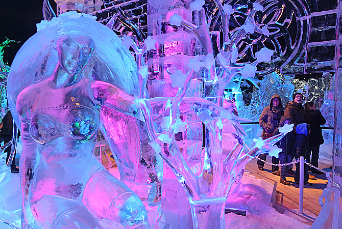 Visitors walk around at the Ice Sculpture festival in Bruges, Belgium, Friday, January 4, 2013. ? AP Photo