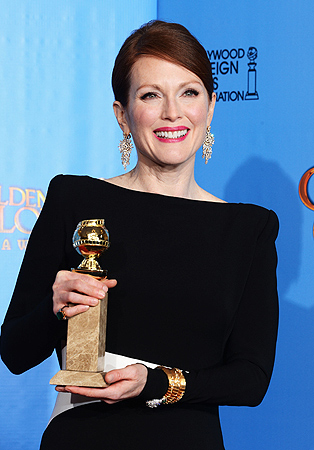 "Actress Julianne Moore, winner of Best Actress in a Mini-Series or a Motion Picture Made for Television for ""Game Change,"" poses in the press room during the 70th Annual Golden Globe Awards held at The Beverly Hilton Hotel. — AFP Photo"