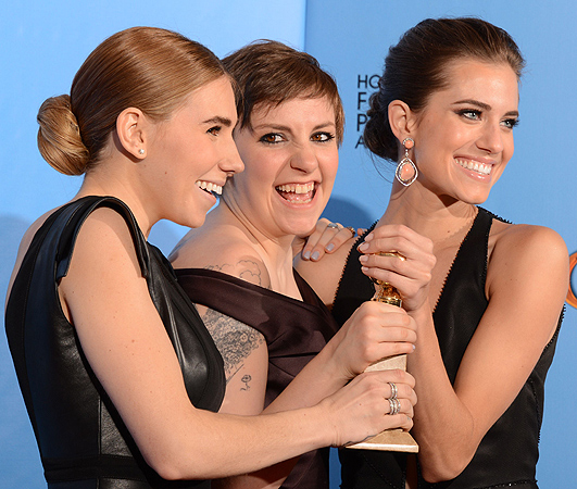 "Lena Dunham (C) poses in the press room with her Best performance by an actress in a television comedy or musical series award for ""Girls"" with co-stars Zosia Mamet (L) and Allison Williams at the Golden Globes awards ceremony. — AFP Photo"