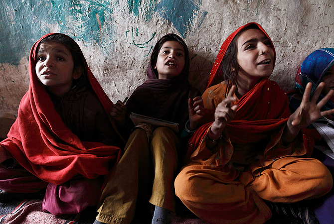 Girls attend class at a school in a slum on the outskirts of Islamabad January 8, 2013. ? Reuters Photo