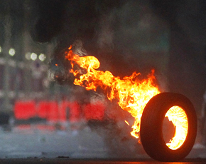 290-burning-tire-AP-Photo