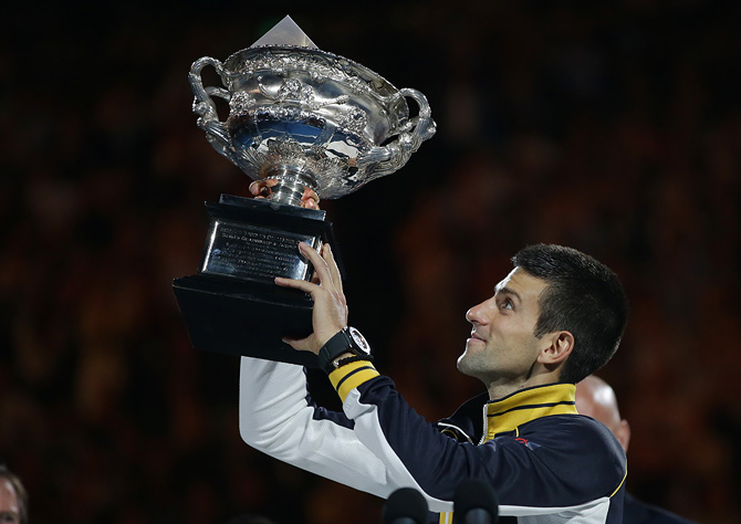 Serbia's Novak Djokovic holds his trophy aloft after defeating Britain's Andy Murray in the men's final at the Australian Open tennis championship in Melbourne, Australia, Sunday, Jan. 27, 2013. – Photo by AP