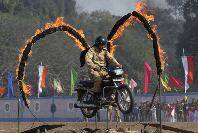 An Indian paramilitary trooper performs a stunt on his motorcycle during the Republic Day parade in Agartala, capital of northeast state Tripura.