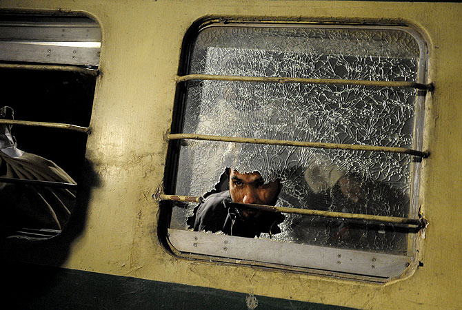 A Pakistani man looks through a broken mirror on the Jaffar Express train after an attack at a railway station in Quetta. – Photo by AFP