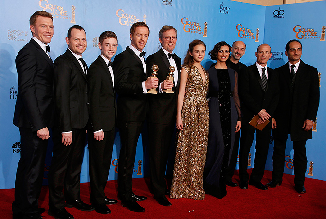 "The cast and producers of the TV drama series ""Homeland,"" from left, actor Diego Klattenhoff, executive producer Gideon Raff, actor Timothie Chalamet, actor Damien Lewis, executive producer Alex Gansa actress Morgan Saylor, actress Morena Baccarin, actor David Marciano, executive producer Howard Gordon and actor Navid Negahban, pose together backstage after ""Homeland"" won the award for Best Drama Series at the 70th annual Golden Globe Awards. — Reuters Photo"