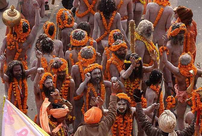 "Indian Naga Sadhus - holy men - of Shri Panchayati Anand Akhara participate in a religious procession as the first ""royal entry"" for the Kumbh Mela at Sangam in Allahabad on January 6, 2013. The Kumbh Mela, which is scheduled to take place in the northern Indian city in January and February 2013, is the world's largest gathering of people for a religious purpose and millions of people gather for this auspicious occasion. ? AFP Photo"